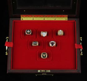 Set of All Six 1990s Chicago Bulls Championship Rings in Custom Display Case - Given to Bulls Official Scorer Bob Rosenberg